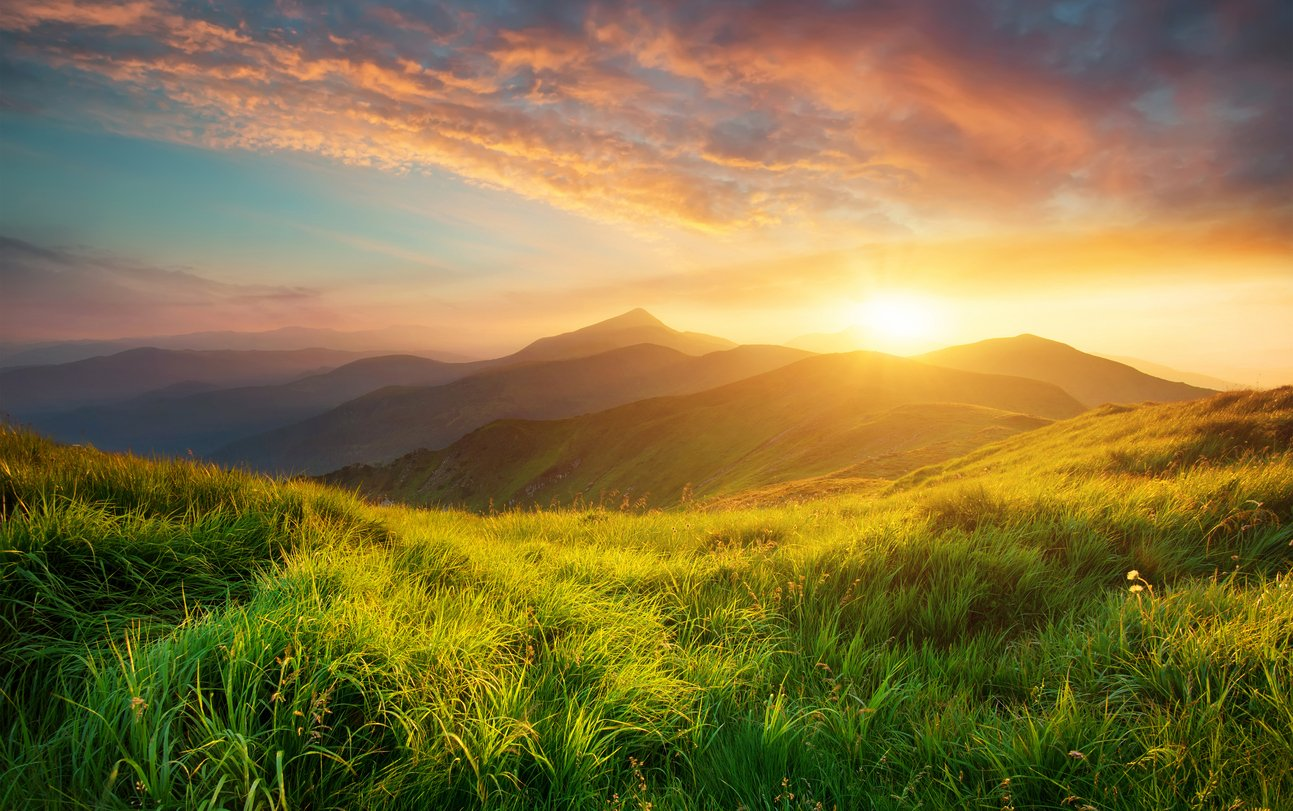 Mountain valley during sunrise. Natural summer landscape.