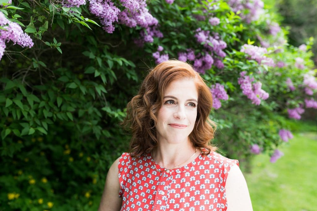 Portrait of Sara Smeaton in her garden, photographed by Amber Ellis