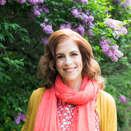 Sara Smeaton, photographed in her garden in front of lilac bushes by Amber Ellis.
